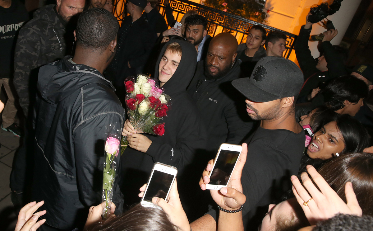 Justin Bieber At Tape Night Club In London with A Bunch Of Roses